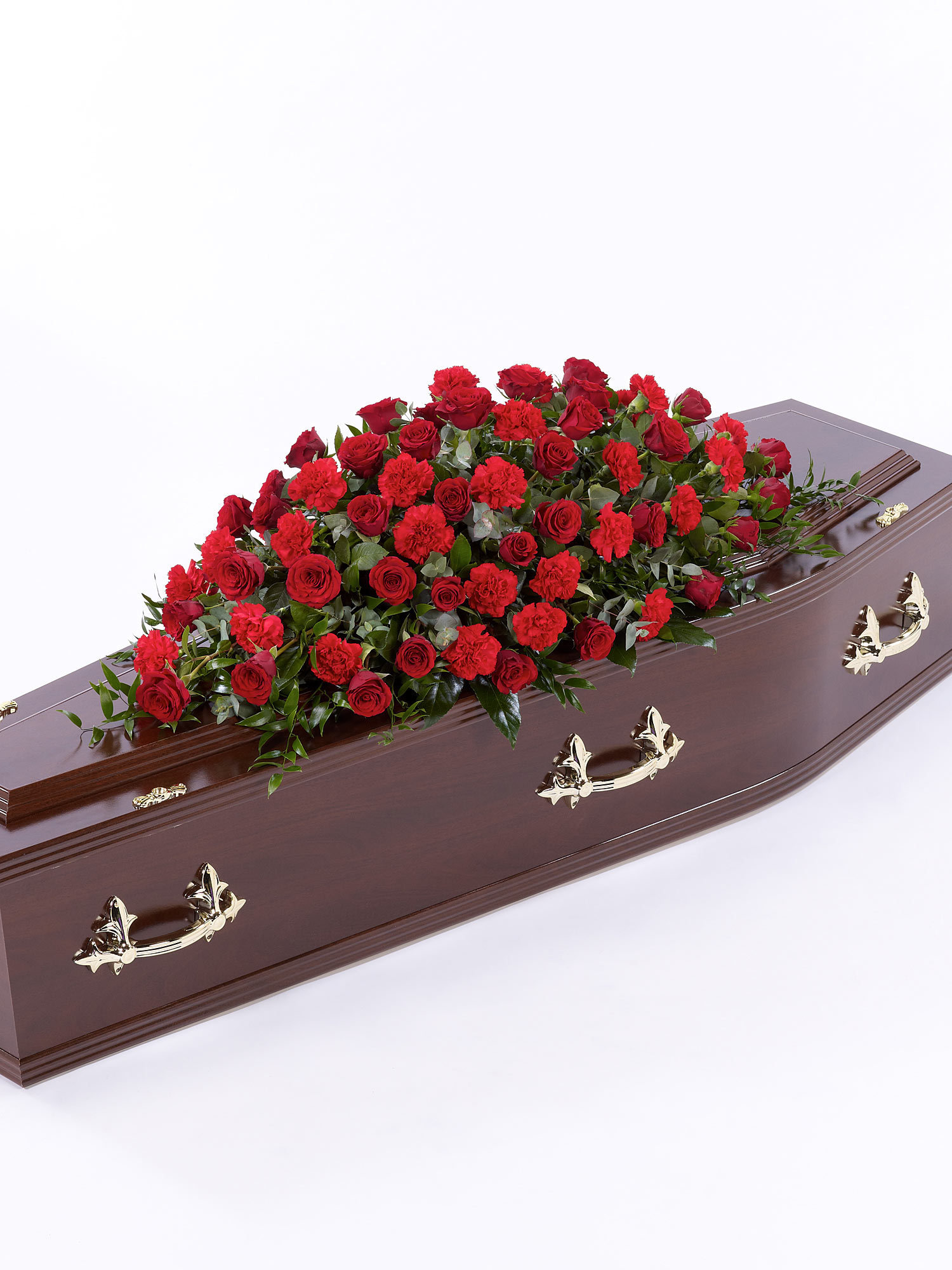 An arrangement of red flowers in a coffin spray