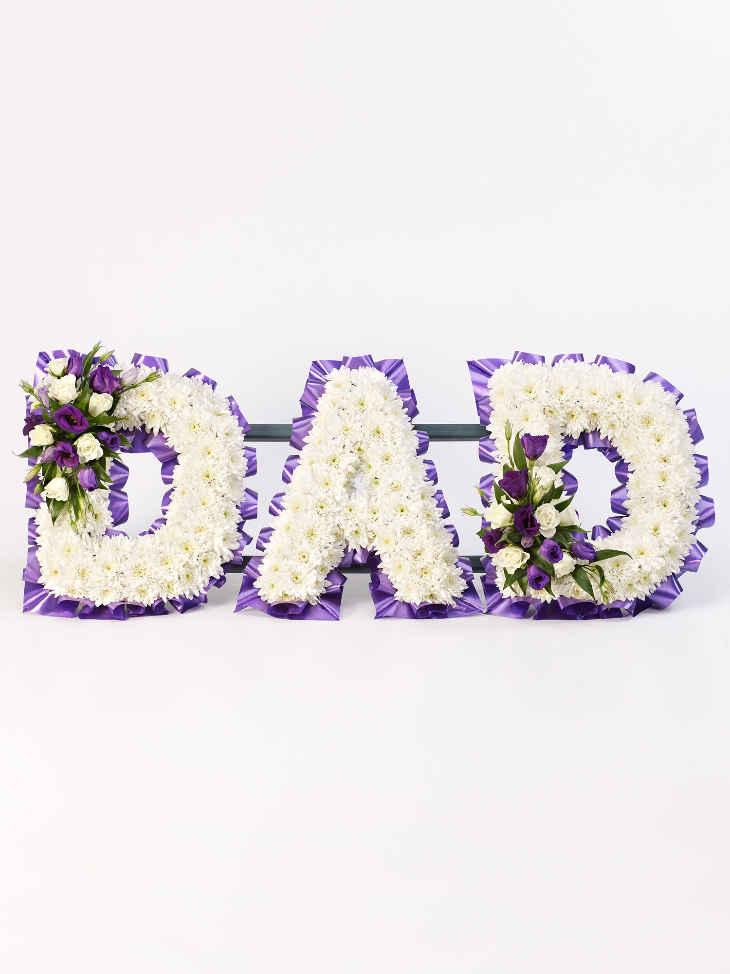 Flowers arranged into letter to form Dad