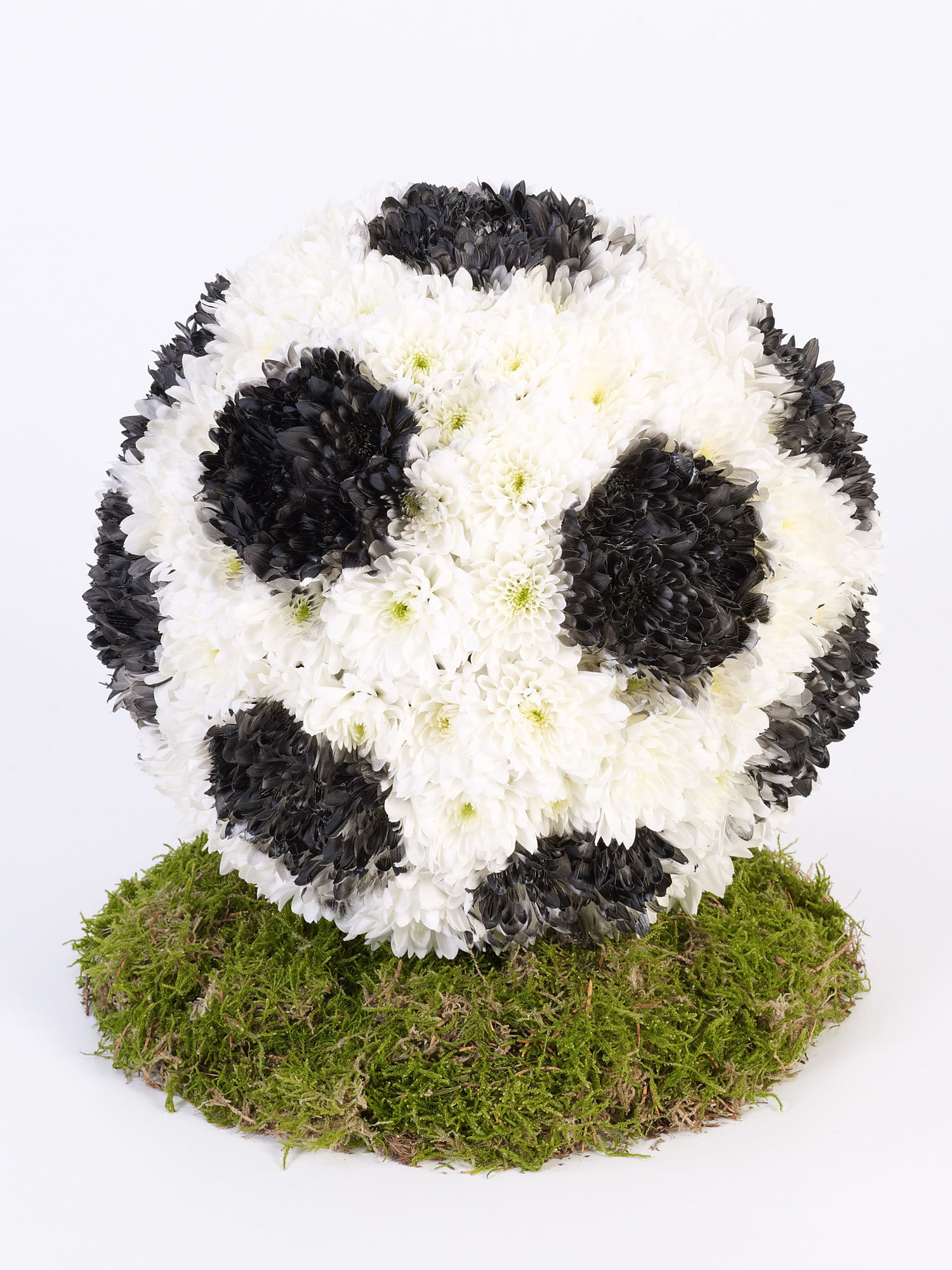 A floral arrangement made to look like a football