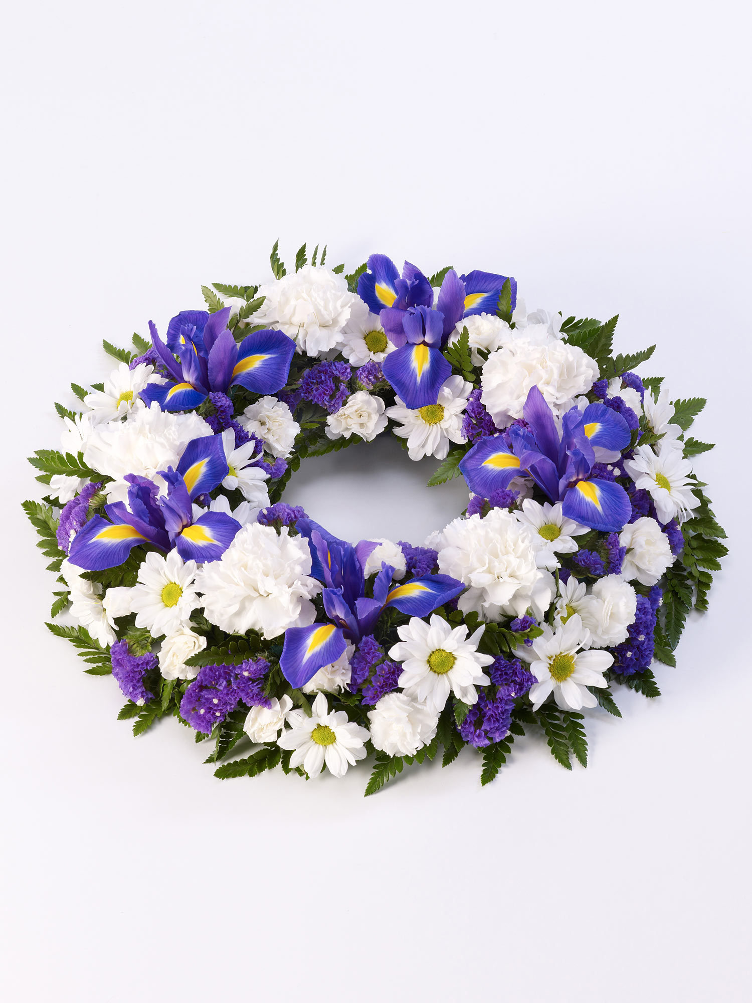 A collection of blue and white flowers forming a wreath